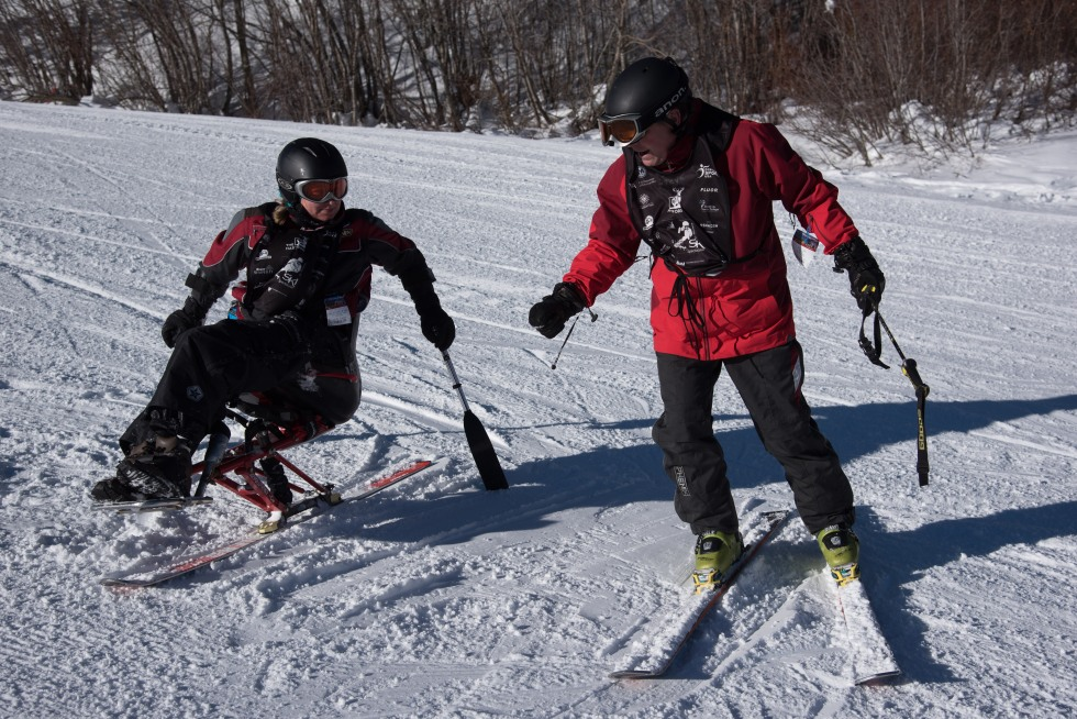 Second day of the 2014 Hartford Ski Spectacular by Disabled Sports USA, morning and afternoon on the mountain with Mattie (skier) and Steve (instructor), from Ohio, her first time here. Then other young people in the adaptive race program, racers on Dukes, other folks and beauty shots. (Photo by Reed Hoffmann on 12/2/14)  NIKON D750, {metering mode}, ISO 200, 1/2000 at f/6.3, EV 0.0, lens at 48mm. Photo copyright Reed Hoffmann.