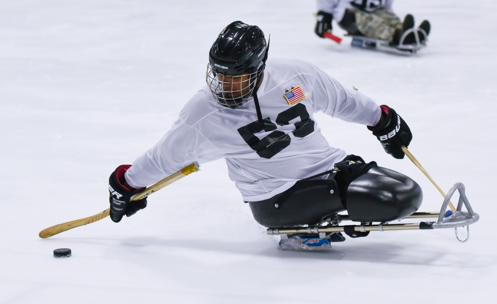 Fifth day of the 2014 Hartford Ski Spectacular by Disabled Sports USA, afternoon curling and sled hockey.  (Photo by Reed Hoffmann on 12/5/14)  NIKON D750, {metering mode}, ISO 2000, 1/1250 at f/2.8, EV 0.0, lens at 85mm. Photo copyright Reed Hoffmann.