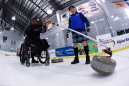 Fifth day of the 2014 Hartford Ski Spectacular by Disabled Sports USA, afternoon curling and sled hockey. (Photo by Reed Hoffmann on 12/5/14) NIKON D750, {metering mode}, ISO 2000, 1/320 at f/5, EV 0.0, lens at 16mm. Photo copyright Reed Hoffmann.