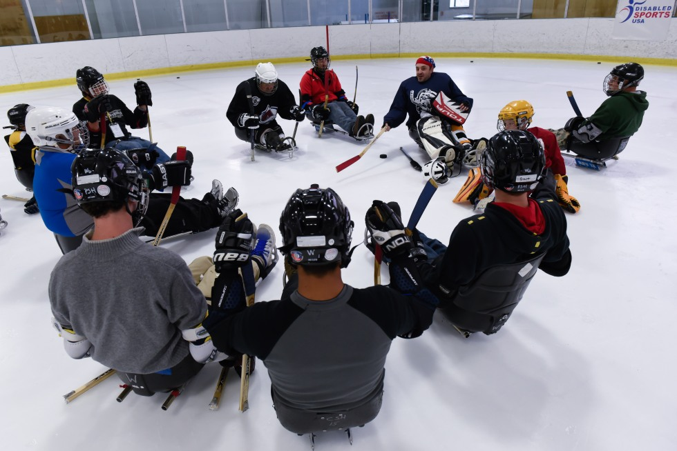 Fifth day of the 2014 Hartford Ski Spectacular by Disabled Sports USA, afternoon curling and sled hockey.  (Photo by Reed Hoffmann on 12/5/14)  NIKON D750, {metering mode}, ISO 2000, 1/160 at f/5.6, EV +0.3, lens at 24mm. Photo copyright Reed Hoffmann.